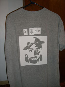 Adhesive backed stencil attached to a shirt